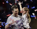 New England Patriots' Tom Brady holds his daughter, Vivian, after the NFL Super Bowl 53 football game against the Los Angeles Rams, Sunday, Feb. 3, 2019, in Atlanta. The Patriots won 13-3. (AP Photo/Jeff Roberson)
