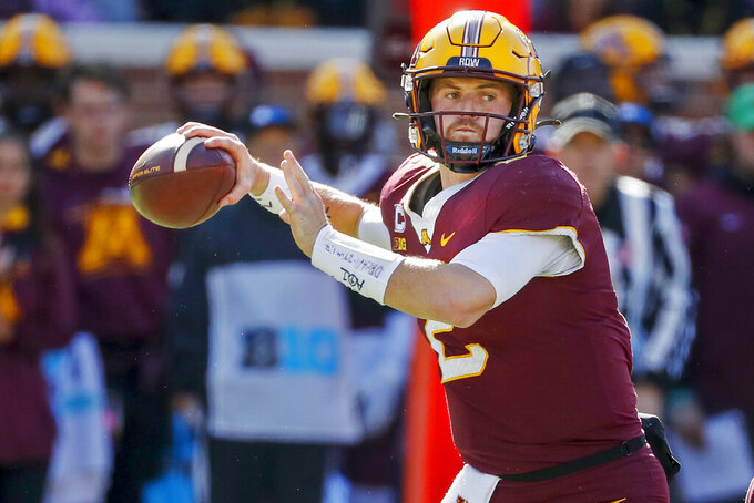 Minnesota quarterback Tanner Morgan (2) passes against Nebraska in the third quarter of an NCAA college football game, Saturday, Oct. 16, 2021, in Minneapolis. Minnesota won 30-23. (AP Photo/Bruce Kluckhohn)