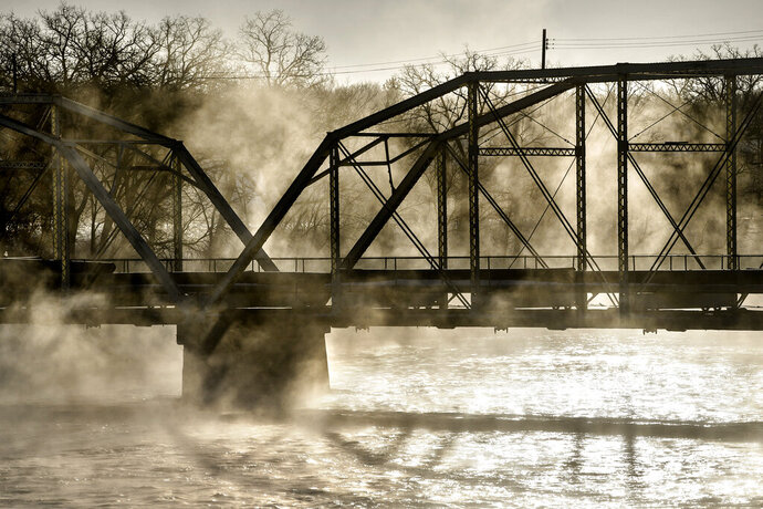 Steam fog rises from open water on the Mississippi River near the old Sartell, Minn., bridge as temperatures hover around minus 18 degrees Fahrenheit, Thursday morning, Feb. 13, 2020, near St. Cloud, Minn.. (Dave Schwarz/St. Cloud Times via AP)
