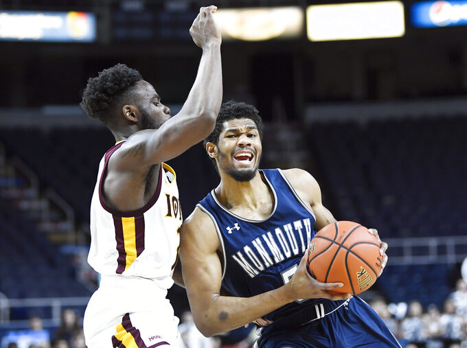 Iona guard Asante Gist, left, defends against Monmouth guard Nick Rutherford (5) during the first half of the championship NCAA college basketball game during the Metro Atlantic Athletic Conference tournament, Monday, March 11, 2019, in Albany, N.Y. (AP Photo/Hans Pennink)