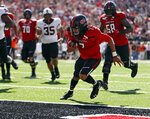 Texas Tech's Jett Duffey (7) scores a touchdown during the first half of an NCAA college football game against Oklahoma State, Saturday, Oct. 5, 2019, in Lubbock, Texas. (AP Photo/Brad Tollefson)