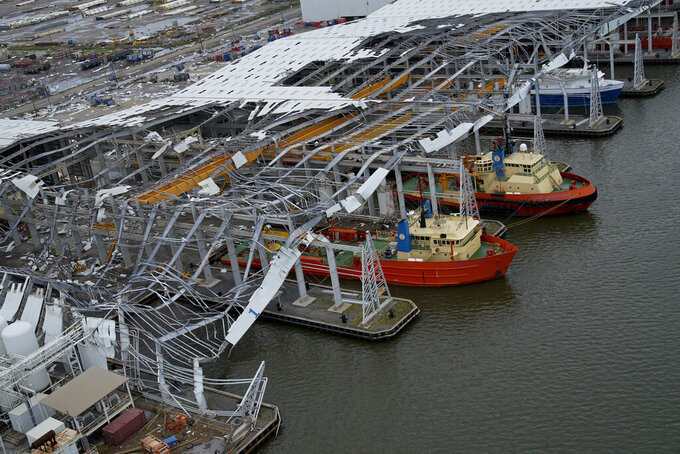 Damage to ship docking facilities are seen in the aftermath of Hurricane Ida in Port Port Fourchon, La., Tuesday, Aug. 31, 2021. (AP Photo/Gerald Herbert)