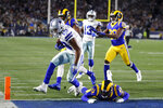Dallas Cowboys wide receiver Amari Cooper, left, scores past Los Angeles Rams strong safety John Johnson during the first half in an NFL divisional football playoff game Saturday, Jan. 12, 2019, in Los Angeles. (AP Photo/Jae C. Hong)