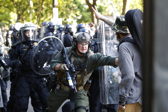 Police begin to clear demonstrators gather as they protest the death of George Floyd, Monday, June 1, 2020, near the White House in Washington. Floyd died after being restrained by Minneapolis police officers. (AP Photo/Alex Brandon)