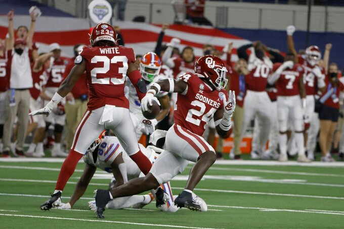 Oklahoma linebacker Brian Asamoah (24) intercepts a pass thrown by Florida quarterback Kyle Trask during the first half of the Cotton Bowl NCAA college football game in Arlington, Texas, Wednesday, Dec. 30, 2020. (AP Photo/Ron Jenkins)