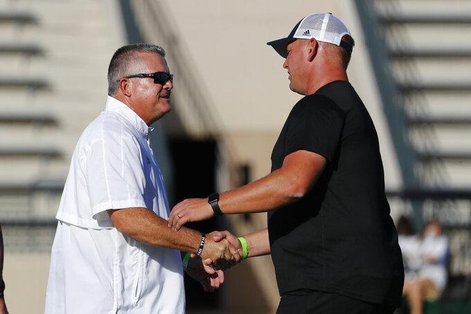 Hawaii head coach Todd Graham, left, and Fresno State head coach Kalen DeBoer meet before an NCAA college football game, Saturday, Oct. 2, 2021, in Honolulu. (AP Photo/Marco Garcia)