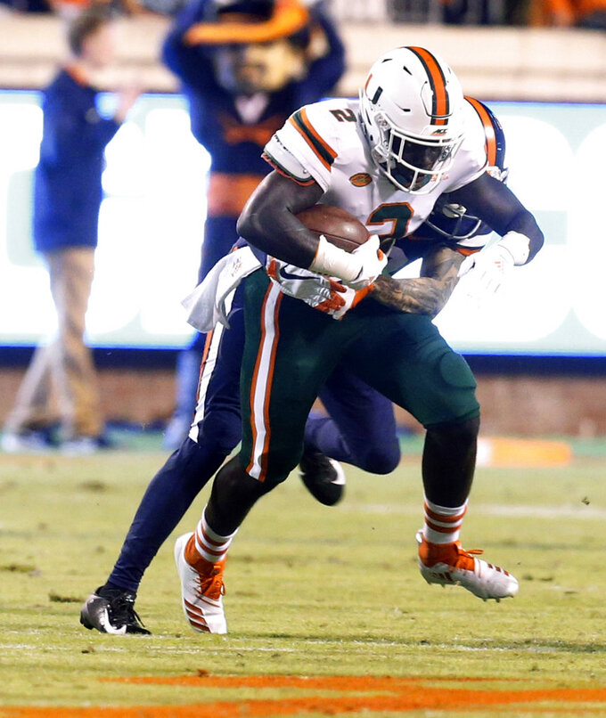 Miami defensive back Trajan Bandy (2) hauls in an interception during the first half of an NCAA college football game against Virginia in Charlottesville, Va., Saturday, Oct. 13, 2018. (AP Photo/Steve Helber)