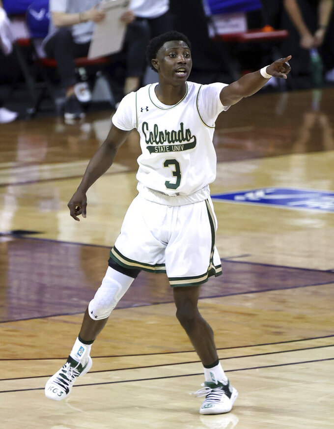 Colorado State guard Kendle Moore (3) yells to a teammate during the first half of an NCAA college basketball game against Fresno State in the quarterfinals of the Mountain West Conference men's tournament Thursday, March 11, 2021, in Las Vegas. (AP Photo/Isaac Brekken)