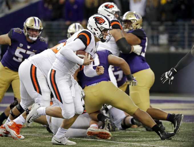 Oregon State quarterback Jack Colletto carries for a touchdown against Washington in the second half of an NCAA college football game Saturday, Nov. 17, 2018, in Seattle. (AP Photo/Elaine Thompson)