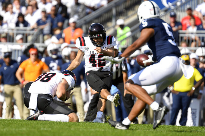 Ball State kicker Jake Chanove (42) kicks a 24-yard field goal in the second quarter against Penn State during an NCAA college football game in State College, Pa., Saturday, Sept. 11, 2021. (AP Photo/Barry Reeger)