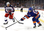 New York Islanders right wing Josh Bailey (12) reaches for the puck as Columbus Blue Jackets defenseman Seth Jones (3) tries to get to it during the second period of an NHL hockey game in New York, Tuesday, Feb. 13, 2018. (AP Photo/Kathy Willens)