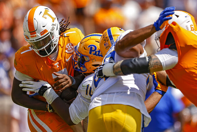 Pittsburgh defensive lineman Keyshon Camp (10) tackles Tennessee quarterback Joe Milton III (7) causing him to fumble during the first half of an NCAA college football game Saturday, Sept. 11, 2021, in Knoxville, Tenn. (AP Photo/Wade Payne)