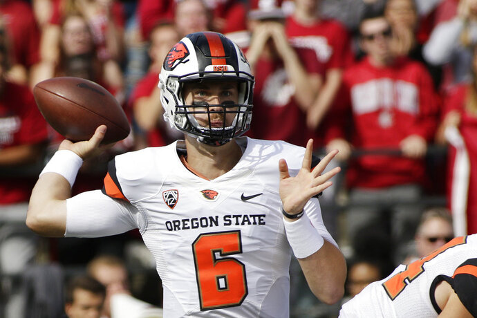 FILE - In this Sept. 16, 2017, file photo, Oregon State quarterback Jake Luton throws a pass during the first half of an NCAA college football game against Washington State in Pullman, Wash. It was still uncertain during the week whether Luton would be back in time for the game against Southern Utah on Saturday, Sept. 8, 2018. He left the opener at Ohio State with concussion-like symptoms after the first series and was replaced by backup Conor Blount. (AP Photo/Young Kwak, File)