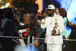 FILE - In this Friday, Nov. 6, 2015, file photo, R. Kelly performs at the 2015 Soul Train Awards at the Orleans Arena in Las Vegas. A federal jury in New York convicted the R&B superstar Monday, Sept. 27, 2021, in a sex trafficking trial. (Photo by Al Powers/ Powers Imagery/Invision/AP, File)