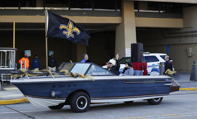 New Orleans Saints fans drive by Mercedes-Benz Superdome before the NFL football NFC championship game against the Los Angeles Rams Sunday, Jan. 20, 2019, in New Orleans. (AP Photo/David J. Phillip)