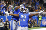 Detroit Lions running back Kerryon Johnson (33) celebrates his 1-yard touchdown run with teammate linebacker Jason Cabinda during the first half of an NFL football game against the Green Bay Packers, Sunday, Dec. 29, 2019, in Detroit. (AP Photo/Rick Osentoski)