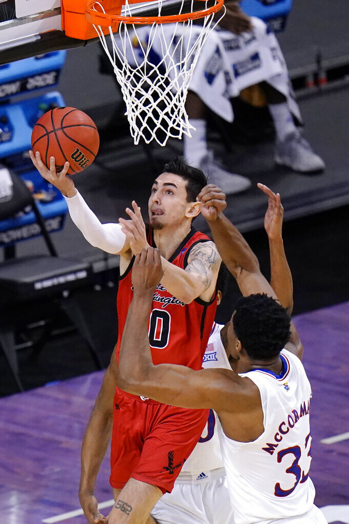 Eastern Washington guard Jacob Davison (10) Goes up for a shot as Kansas forward David McCormack (33) defends during the first half of a first-round game in the NCAA college basketball tournament at Farmers Coliseum in Indianapolis, Saturday, March 20, 2021. (AP Photo/AJ Mast)