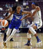 Connecticut Sun's DeWanna Bonner (24) attempts to move past Minnesota Lynx's Napheesa Collier (24) duringWNBA basketball game Tuesday, Aug. 17, 2021, in Uncasville, Conn. (Sarah Gordon/The Day via AP)