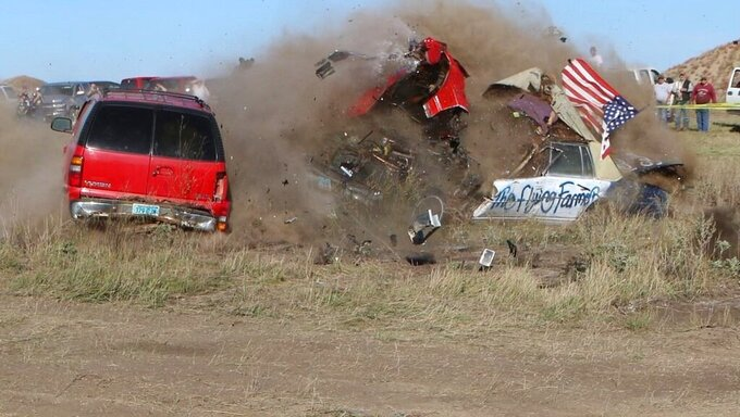 Daredevil John Smith, known as the Flying Farmer, crashes his Chevrolet Caprice while attempting a jump on Saturday, Sept. 25, 2021 in Makoti, N.D. He suffered unknown injuries and was flown to a Minot hospital. (Hunter Andes/The Bismarck Tribune via AP)