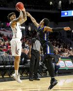 Cincinnati guard Jarron Cumberland (34) rises for a shot as Tulsa guard Isaiah Hill (4) defends during the first half of an NCAA college basketball game Wednesday, Jan. 8, 2020, in Cincinnati. (Kareem Elagazzar/The Cincinnati Enquirer via AP)