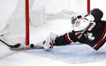 Northeastern goaltender Cayden Primeau dives as he makes a stick save on a shot by Boston College forward Aapeli Räsänen during the third period of the NCAA hockey Beanpot tournament championship game in Boston, Monday, Feb. 11, 2019. (AP Photo/Charles Krupa)