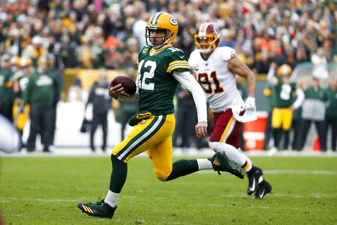 Green Bay Packers' Aaron Rodgers runs for a first down during the first half of an NFL football game against the Washington Redskins Sunday, Dec. 8, 2019, in Green Bay, Wis. (AP Photo/Matt Ludtke)