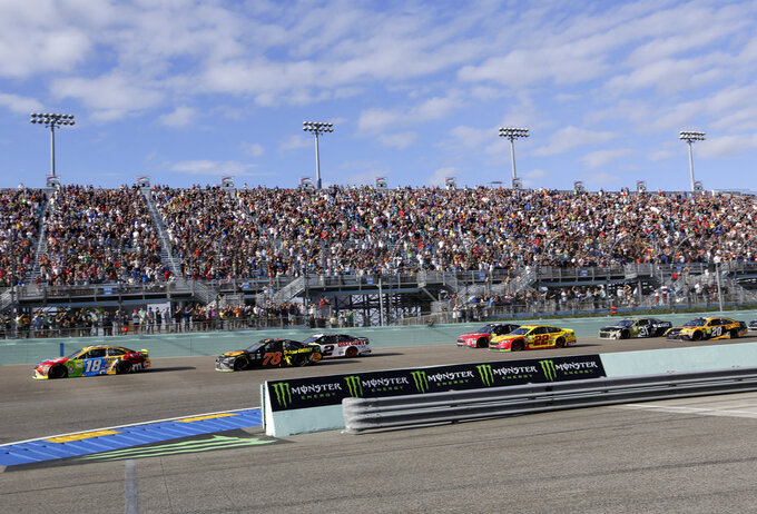 Kyle Busch (18) approaches Turn 1 during the NASCAR Cup Series championship auto race at Homestead-Miami Speedway, Sunday, Nov. 18, 2018, in Homestead, Fla. (AP Photo/Lynne Sladky)