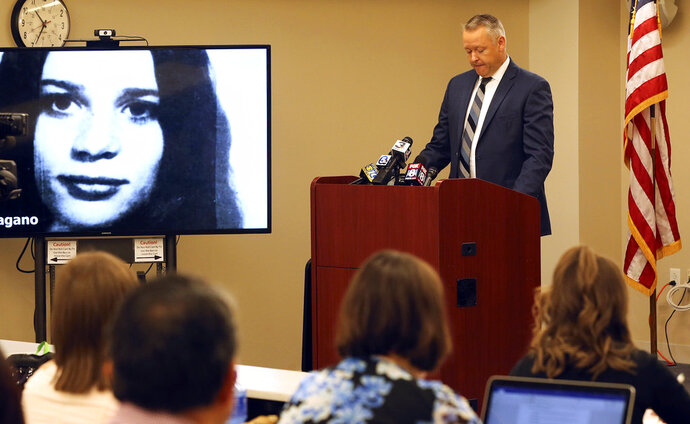 Jesse T. Leeser, Akron Police deputy chief, talks about the case during a news conference updating the Linda Pagano case at the Cuyahoga County Medical Examiner's office on Thursday, July 12, 2018, in Cleveland, Ohio. Authorities said DNA testing and perseverance have led to the identity of Pagano, a 17-year-old Ohio girl who went missing 44 years ago and whose remains were found in an unmarked grave. Police that Pagano's missing persons case is now a homicide investigation. (Mike Cardew/Akron Beacon Journal via AP)