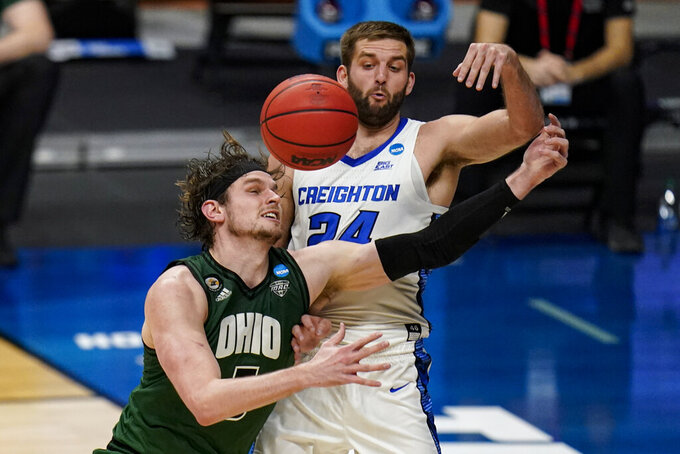Creighton guard Mitch Ballock (24) and Ohio forward Ben Vander Plas (5) fight for a rebound in the second half of a second-round game in the NCAA men's college basketball tournament at Hinkle Fieldhouse in Indianapolis, Monday, March 22, 2021. (AP Photo/Michael Conroy)
