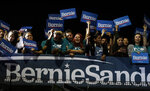 Supporters of Democratic presidential candidate Sen. Bernie Sanders, I-Vt., cheer as they watch results of the Nevada Cacus during a campaign event in San Antonio, Saturday, Feb. 22, 2020. (AP Photo/Eric Gay)