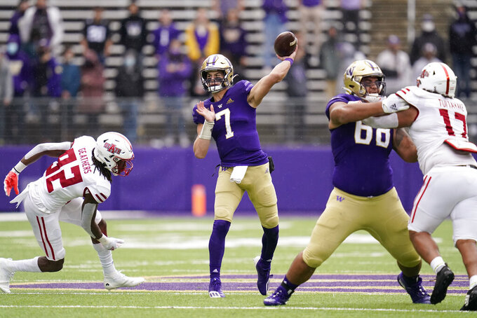 Washington quarterback Sam Huard (7) throws against Arkansas State in the second half of an NCAA college football game, Saturday, Sept. 18, 2021, in Seattle. (AP Photo/Elaine Thompson)