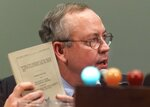 FILE - In this Nov. 19, 1998 file photo, Independent Counsel Kenneth Starr holds up his report while testifying on Capitol Hill, before the House Judiciary Committee's impeachment hearing. (AP Photo/Joe Marquette)