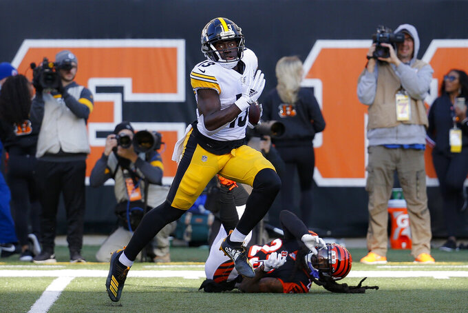Pittsburgh Steelers wide receiver James Washington (13) runs for a touchdown during the second half an NFL football game against the Cincinnati Bengals, Sunday, Nov. 24, 2019, in Cincinnati. (AP Photo/Frank Victores)