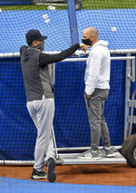 New York Yankees manager Aaron Boone, left, talks with general manager Brian Cashman, right, during batting practice before a baseball game against the Toronto Blue Jays in Buffalo, N.Y., Monday, Sept. 7, 2020. (AP Photo/Adrian Kraus)