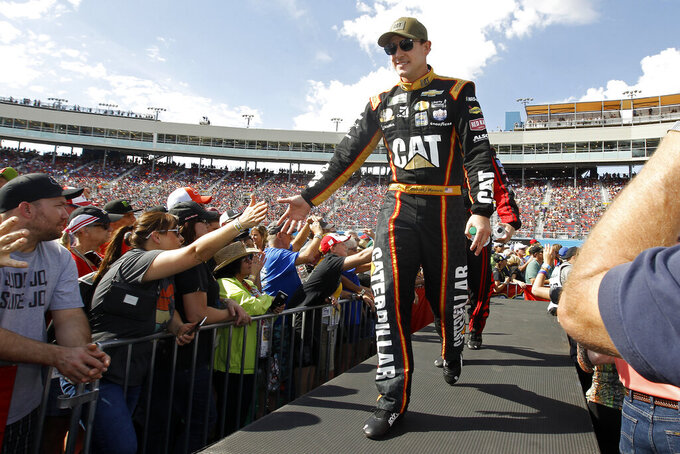 Daniel Hemric greets fans during driver introductions prior to the NASCAR Cup Series auto race at ISM Raceway, Sunday, Nov. 10, 2019, in Avondale, Ariz. (AP Photo/Ralph Freso)
