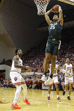 Michigan State forward Malik Hall (25) goes up for a dunk in front of Indiana forward De'Ron Davis (20) in the second half of an NCAA college basketball game in Bloomington, Ind., Thursday, Jan. 23, 2020. (AP Photo/Darron Cummings)