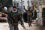 In this photo released Sunday, Feb. 16, 2020 by the Syrian official news agency SANA, Syrian army soldiers flash the victory sign in the Rashideen neighborhood, in Aleppo province, Syria. Syria's military announced on Monday that its troops have regained control of territories in northwestern Syria