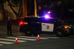 San Jose Police investigate a possible stabbing at Grace Baptist Church at the corner of South 10th and East San Fernando Streets in downtown San Jose, Calif., Sunday, Nov. 22, 2020. Two people died and multiple others were injured in a stabbing Sunday night at a church in California where homeless people had been brought to shelter from the cold weather, police said. (Nhat V. Meyer/Bay Area News Group via AP)