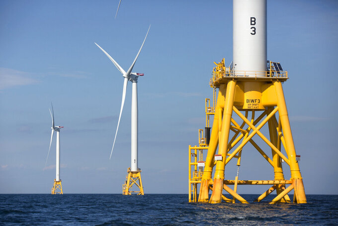 FILE - In this Aug. 15, 2016 file photo, three of Deepwater Wind's five turbines stand in the water off Block Island, R.I. On June 3, 2021, Atlantic Shores Offshore Wind announced a study with Rutgers University and the New Jersey clam industry of how offshore wind energy projects might impact the clam industry over the next 30 years.(AP Photo/Michael Dwyer, File)