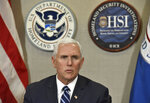 Vice President Mike Pence talks with ICE top officials before he receives a briefing at Homeland Security Investigation Principal Field Offices in Atlanta on Thursday, March 21, 2019.  (Hyosub Shin/Atlanta Journal-Constitution via AP, Pool)