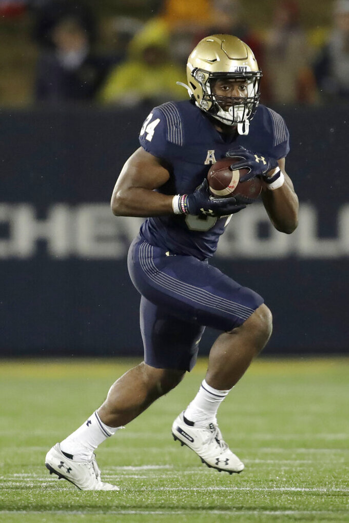 Navy fullback Jamale Carothers runs with the ball against SMU during the first half of an NCAA college football game, Saturday, Nov. 23, 2019, in Annapolis, Md. (AP Photo/Julio Cortez)
