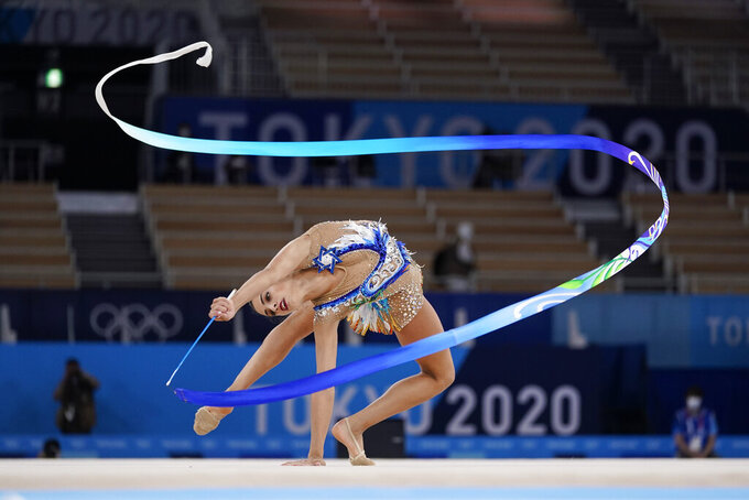 Linoy Ashram, of Israel, performs during the rhythmic gymnastics individual all-around final at the 2020 Summer Olympics, Saturday, Aug. 7, 2021, in Tokyo, Japan. (AP Photo/Ashley Landis)