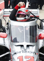 IndyCar driver Will Power lowers into his car as he prepares to drive in IndyCar Series Open Testing, Wednesday, Feb. 12, 2020, in Austin, Texas. (AP Photo/Eric Gay)