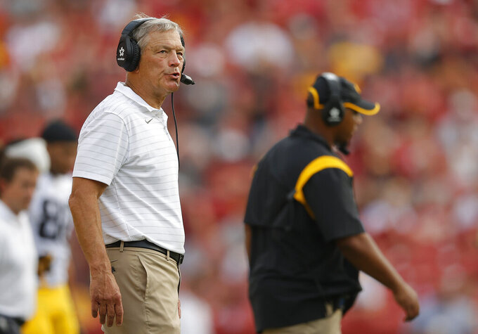 Iowa head coach Kirk Ferentz paces the sidelines during the second half of an NCAA college football game against Iowa State, Saturday, Sept. 11, 2021, in Ames, Iowa. Iowa won 27-17. (AP Photo/Matthew Putney)