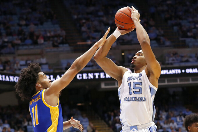 North Carolina forward Garrison Brooks (15) shoots against Pittsburgh guard Justin Champagnie (11) during the first half of an NCAA college basketball game in Chapel Hill, N.C., Wednesday, Jan. 8, 2020. (AP Photo/Gerry Broome)