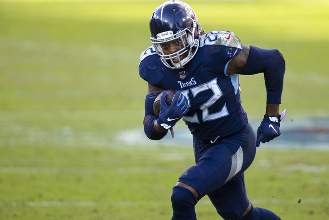 FILE - In this Dec. 20, 2020, file photo, Tennessee Titans running back Derrick Henry (22) carries ball against the Detroit Lions during the fourth quarter of an NFL football game in Nashville, Tenn. Henry as named The Associated Press Offensive Player of the Year on Saturday, Feb. 6, at the NFL Honors. (AP Photo/Brett Carlsen, File)