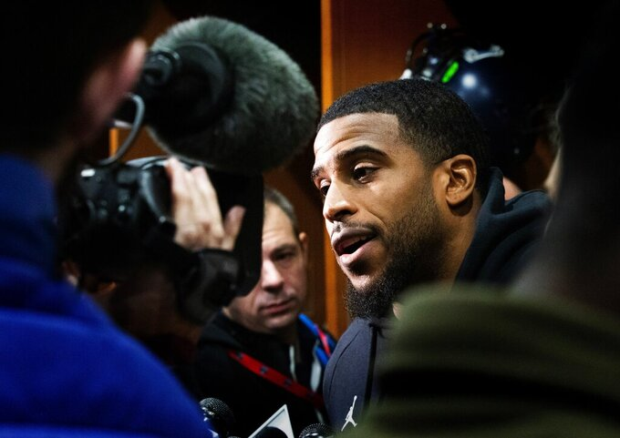The media surrounds Seattle Seahawks' Bobby Wagner during an interview as football players clean out their lockers at Seahawks headquarters in Renton, Wash. Monday, Jan. 13, 2020. (Ellen M. Banner/The Seattle Times via AP)