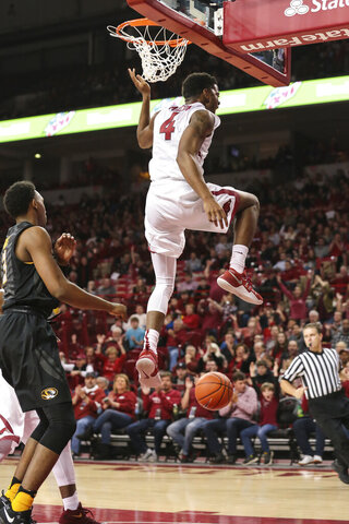 Arkansas' guard Daryl Macon (4)