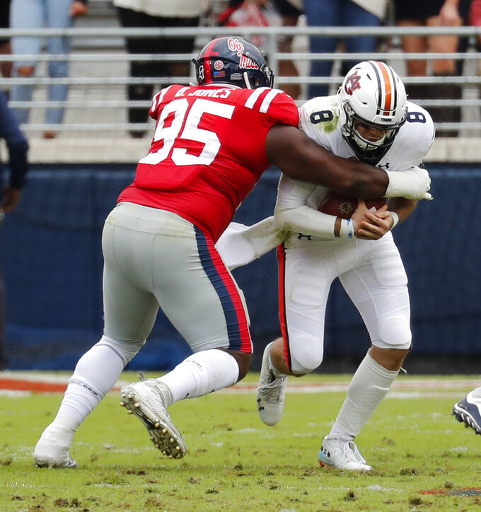 Auburn quarterback Jarrett Stidham (8) is sacked by Mississippi defensive tackle Benito Jones (95) during the first half of an NCAA college football game on Saturday, Oct. 20, 2018, in Oxford, Miss. Auburn won 31-16. (AP Photo/Rogelio V. Solis)