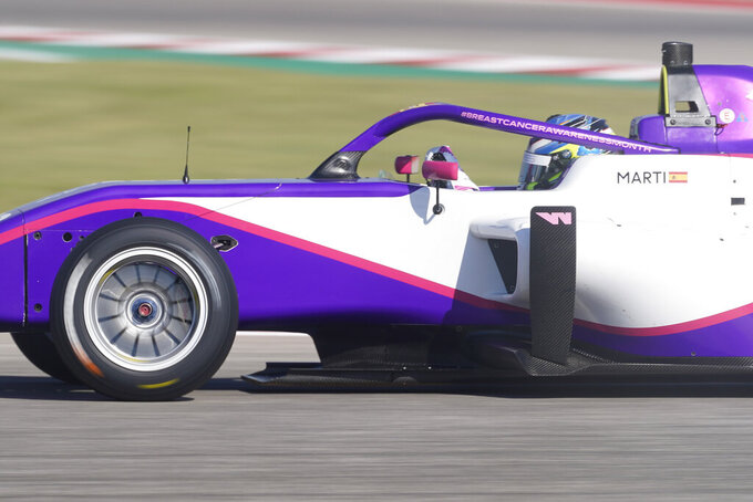 NereaMarti, of Spain, drives into a turn during a practice session for the W Series auto race at Circuit of the Americas, Friday, Oct. 22, 2021, in Austin, Texas. (AP Photo/Darron Cummings)